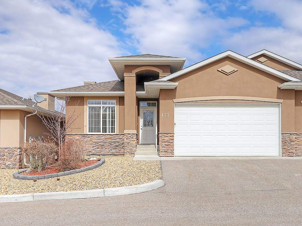 MLS® #C4182373 - 133 River Heights Vw in River Heights Cochrane, Attached Open Houses
