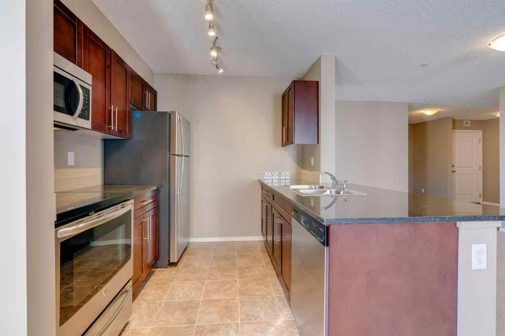 MLS® # A1032027 - Unit #9302 403 MACKENZIE  Way SW in Luxstone Airdrie, Residential Open Houses