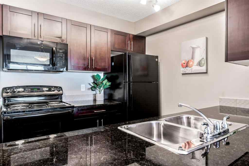 MLS® #A1036070 - Unit #6404 403 MacKenzie Way SW in Downtown Airdrie, Residential Open Houses