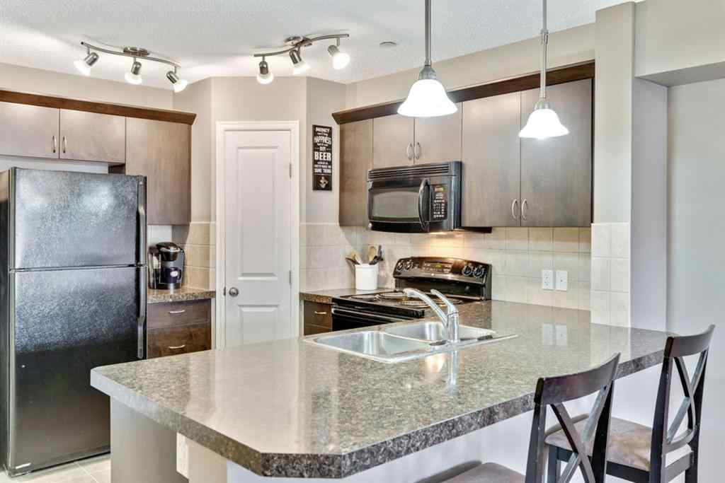 MLS® # A1044769 - Unit #1103 4 Kingsland Close SE in Kings Heights Airdrie, Residential Open Houses