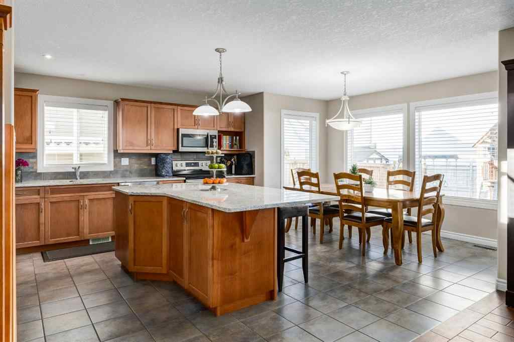 MLS® # A1048090 - 1464 Kings Heights Boulevard SE in Kings Heights Airdrie, Residential Open Houses