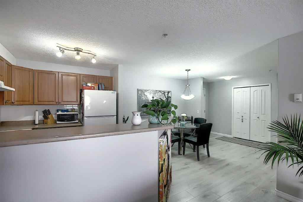 MLS® # A1049614 - Unit #8216 304 Mackenzie Way SW in Downtown Airdrie, Residential Open Houses