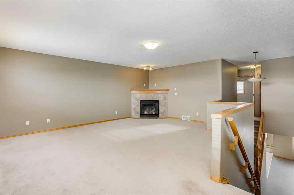 MLS® # A1051316 - 1209 Kingsland Road SE in Kings Heights Airdrie, Residential Open Houses
