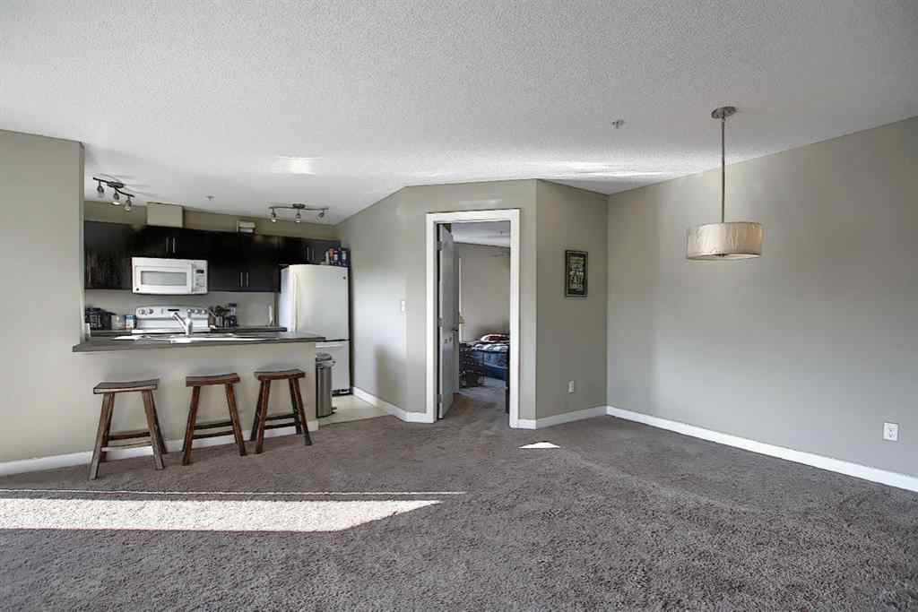 MLS® # A1052642 - Unit #2413 403 Mackenzie Way SW in Downtown Airdrie, Residential Open Houses