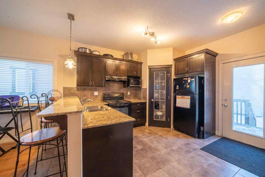 MLS® # A1069497 - 1113 Channelside Way SW in Canals Airdrie, Residential Open Houses