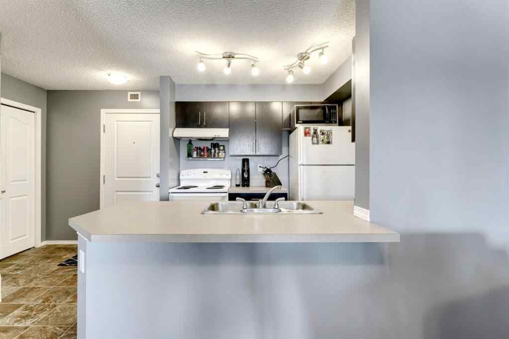 MLS® # A1071215 - Unit #4310 403 Mackenzie Way SW in Downtown Airdrie, Residential Open Houses