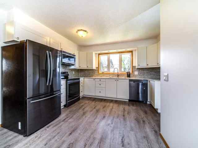 MLS® #C4288915 1472 Lake Michigan CR Se T2J 3G1 Calgary
