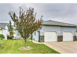 186 Woodside CL Nw, Airdrie Woodside Attached Real Estate: