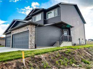 Attached Strathmore Lakes Estates real estate listing Strathmore