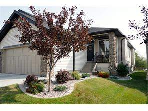 Crystal Shores Real Estate: Attached home Okotoks