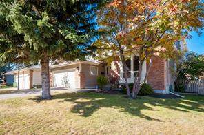 836 Shawnee DR Sw, Calgary, Detached homes