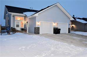 748 Carriage Lane Dr, Carstairs, Attached homes