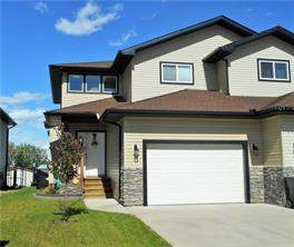 764 Carriage Lane Dr, Carstairs