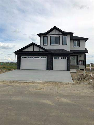 1338 Lackner Bv, Carstairs  Carstairs homes for sale