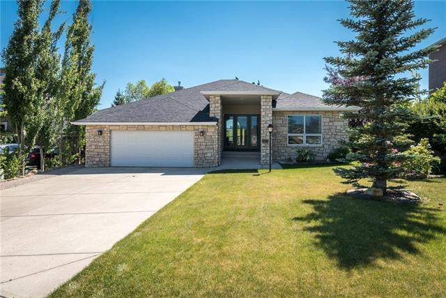 115 Lynx Ln, Rural Rocky View County  Springbank Links homes for sale