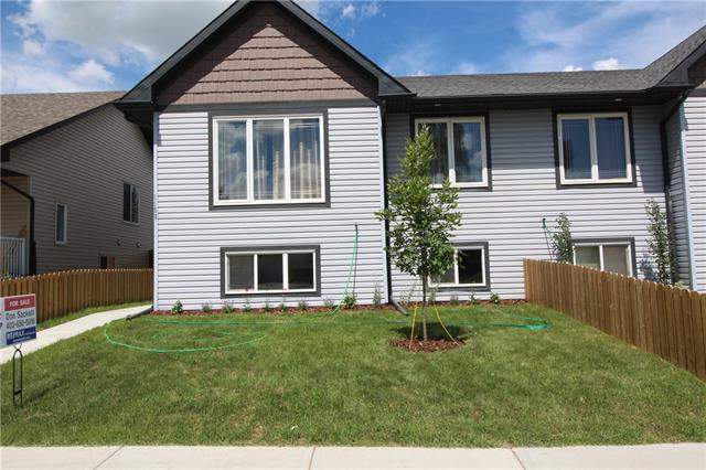1108 Limit Av, Crossfield  Crossfield homes for sale