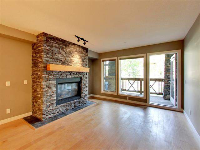 #118 106 Stewart Creek Ld, Canmore, Three Sisters real estate, Apartment Three Sisters homes for sale