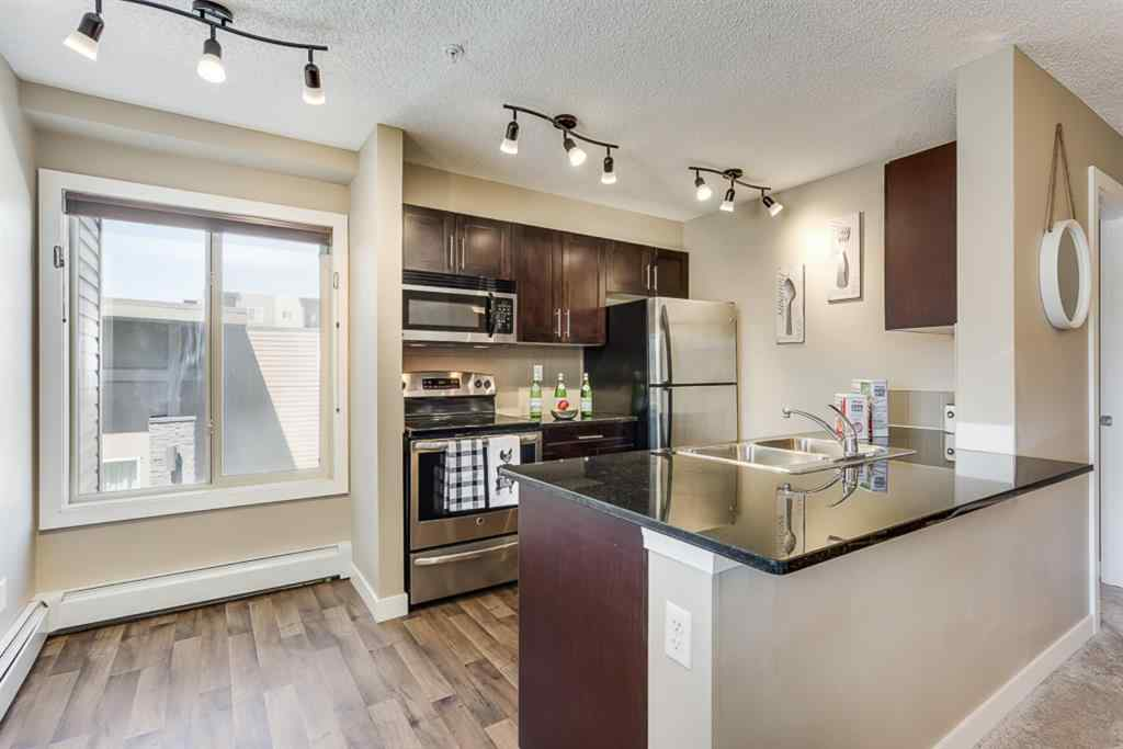 MLS® #A1015436 - Unit #4201 403 MACKENZIE  Way SW in Downtown. Airdrie, Residential Open Houses
