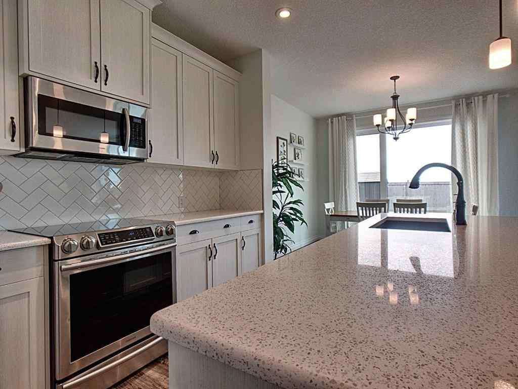 MLS® # A1020618 - 39 Ravenscroft Close SE in Ravenswood Airdrie, Residential Open Houses