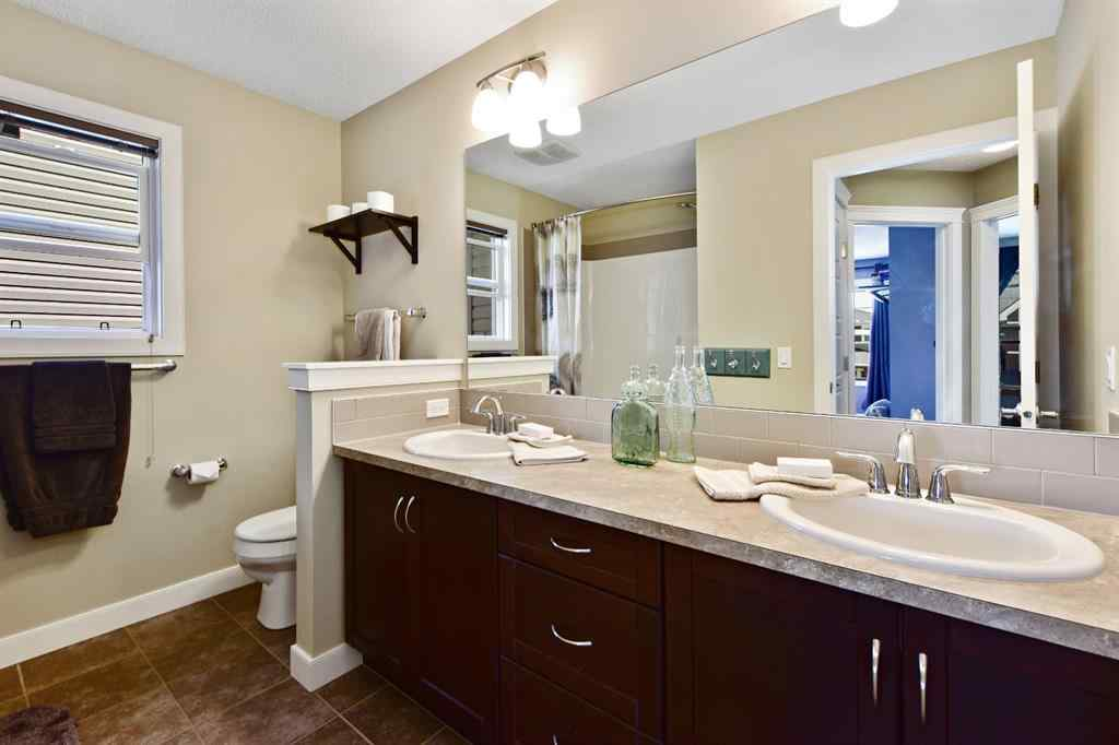 MLS® #A1022191 - 215 RAVENSCROFT  Green SE in Ravenswood Airdrie, Residential Open Houses