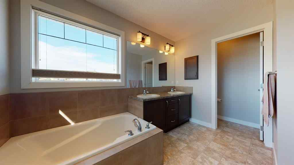 MLS® #A1025806 - 1934 BAYWATER  Alley SW in Bayside Airdrie, Residential Open Houses
