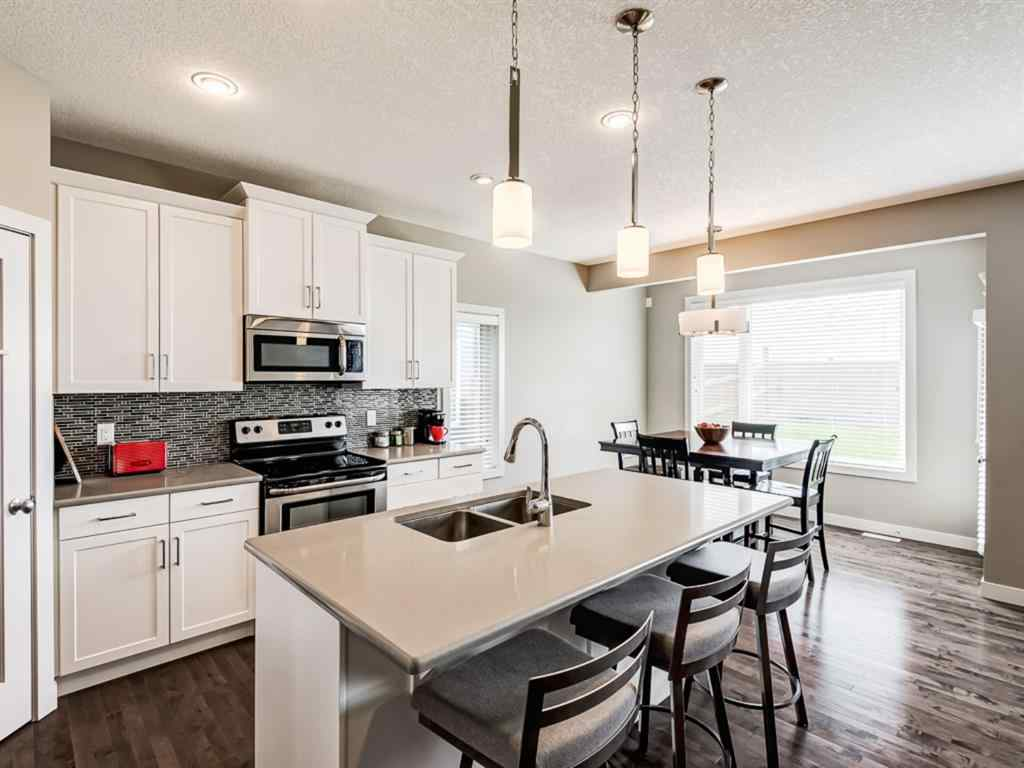 MLS® # A1027246 - 1422 RAVENSCROFT  Avenue SE in Ravenswood Airdrie, Residential Open Houses