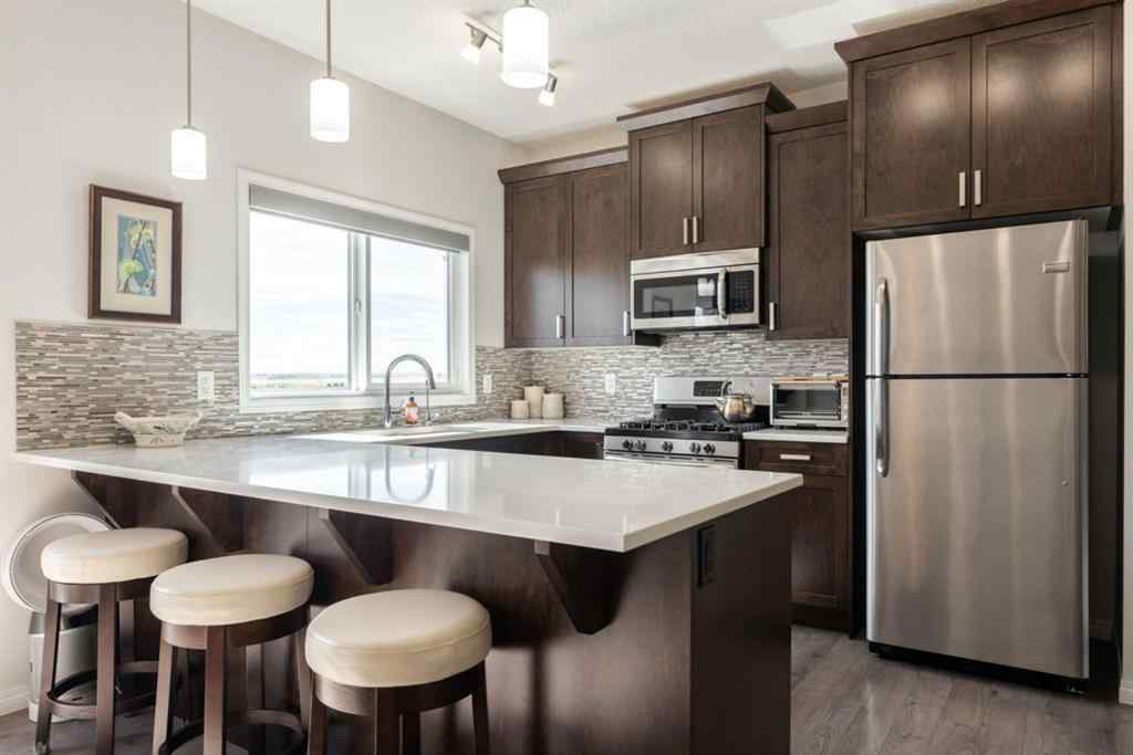 MLS® #A1028613 - 337 HILLCREST  Road SW in Hillcrest Airdrie, Residential Open Houses
