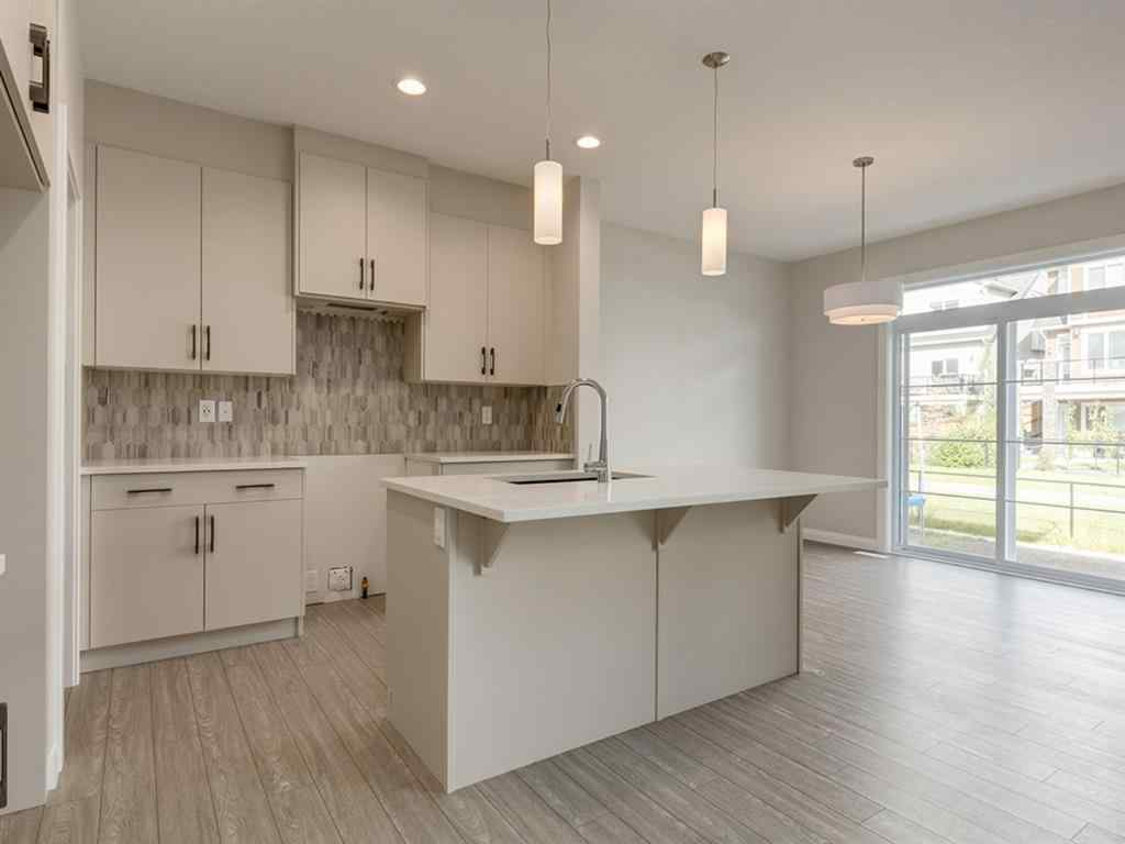 MLS® #A1030719 - 209 RAVENSTERN  Crescent SE in Ravenswood Airdrie, Residential Open Houses