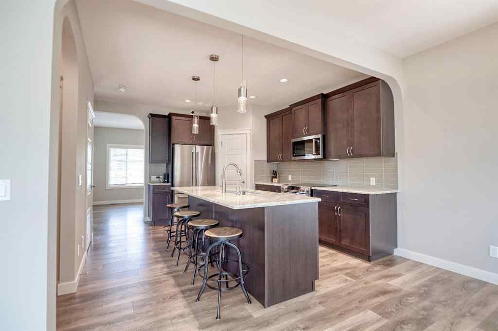MLS® # A1031277 - 87 RAVENSMOOR  Manor SE in Ravenswood Airdrie, Residential Open Houses