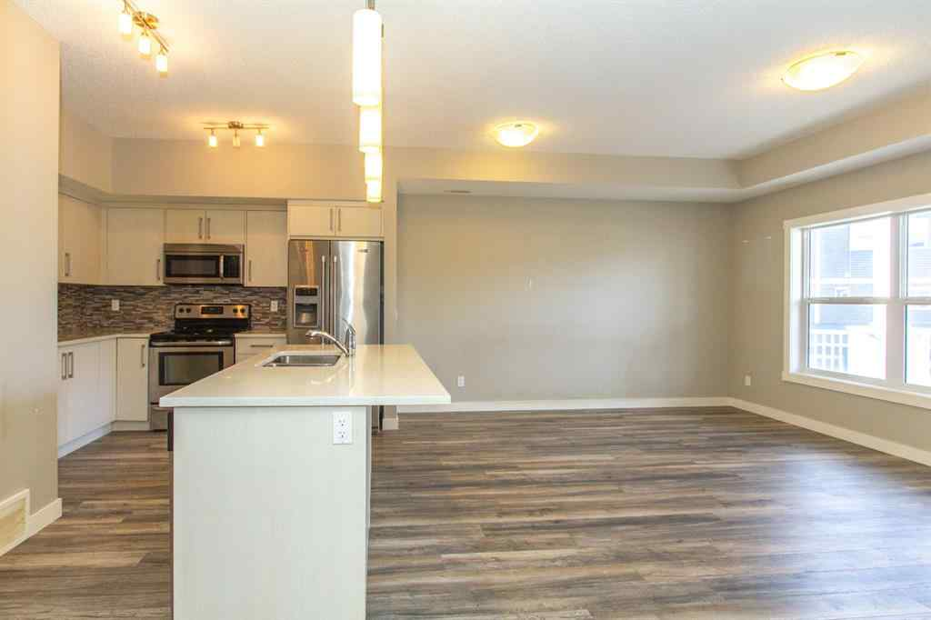 MLS® #A1031838 - Unit #1101 1225 KINGS HEIGHTS Way SE in Kings Heights Airdrie, Residential Open Houses
