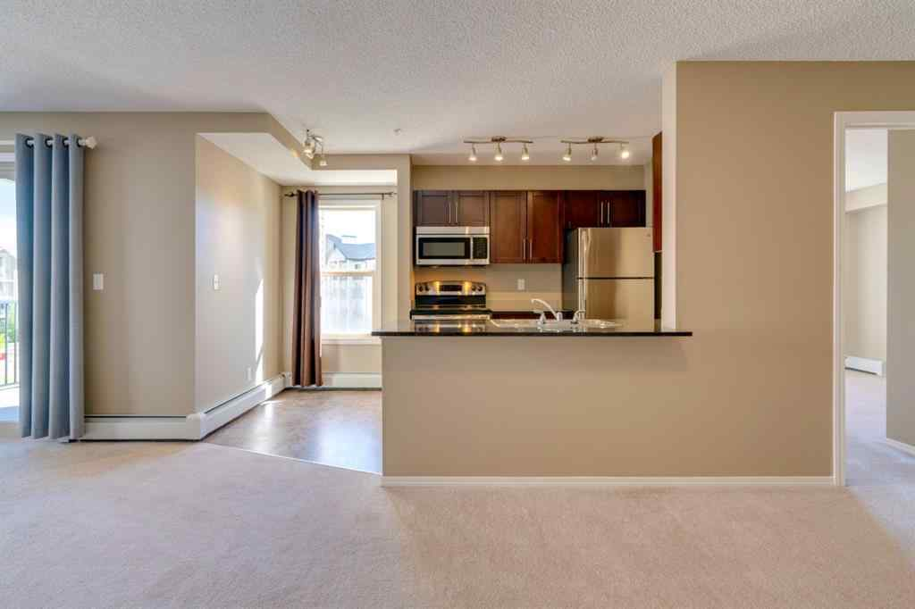 MLS® #A1032027 - Unit #9302 403 MACKENZIE  Way SW in Luxstone Airdrie, Residential Open Houses