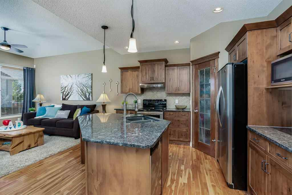 MLS® #A1032821 - 1058 PRAIRIE SPRINGS Hill SW in Prairie Springs Airdrie, Residential Open Houses