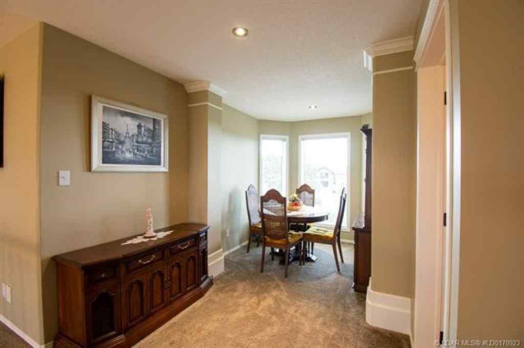 MLS® #A1033981 - 16 Sandstone Road S in Southridge Lethbridge, Residential Open Houses