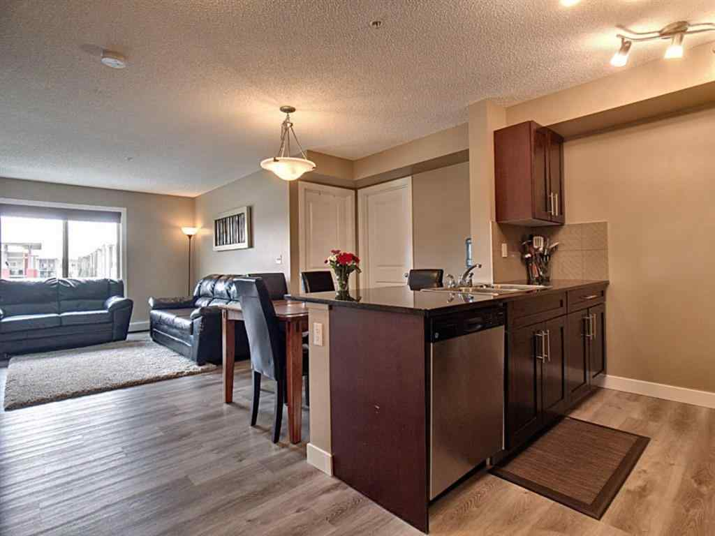 MLS® #A1034265 - Unit #7306 403 MacKenzie Way SW in Downtown Airdrie, Residential Open Houses