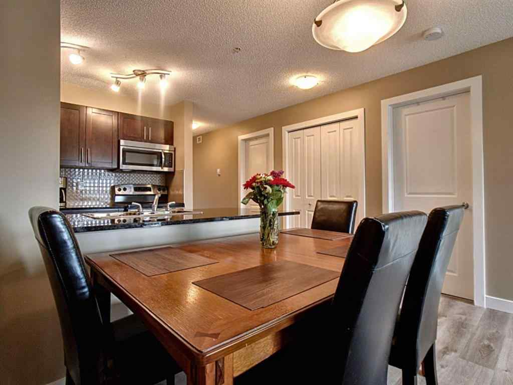 MLS® #A1034265 - Unit #7306 403 MacKenzie Way SW in Downtown. Airdrie, Residential Open Houses