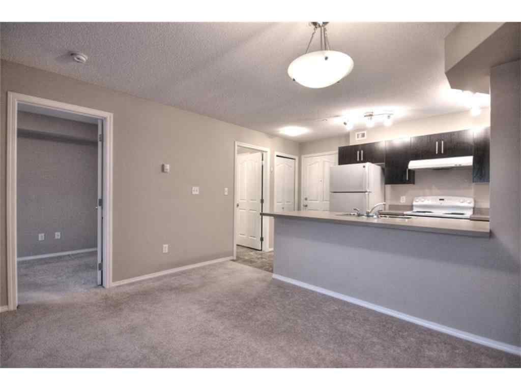 MLS® #A1034945 - Unit #2110 403 MACKENZIE Way SW in Downtown Airdrie, Residential Open Houses