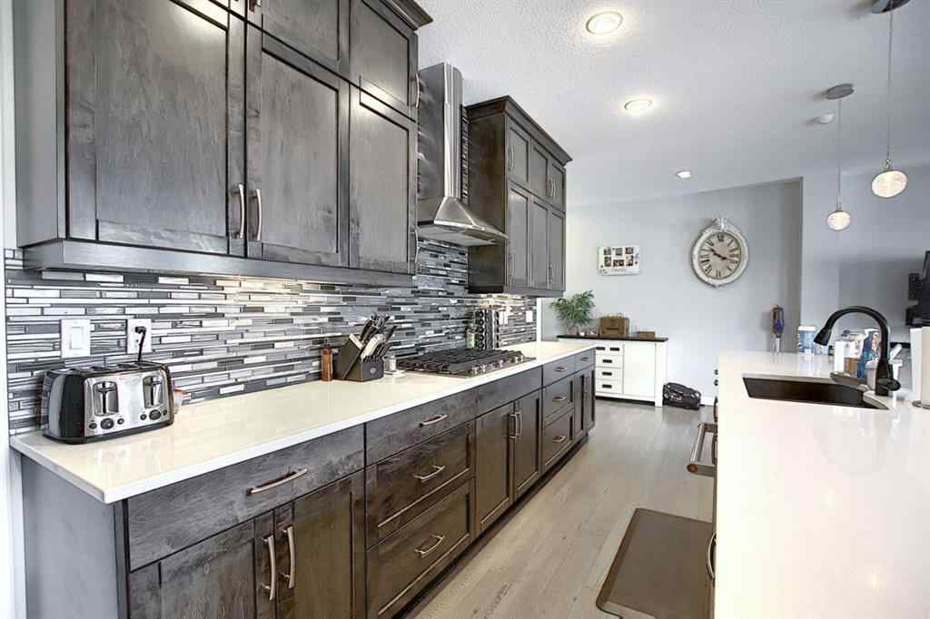 MLS® #A1036468 - 56 RAVENSKIRK  Close SE in Ravenswood Airdrie, Residential Open Houses