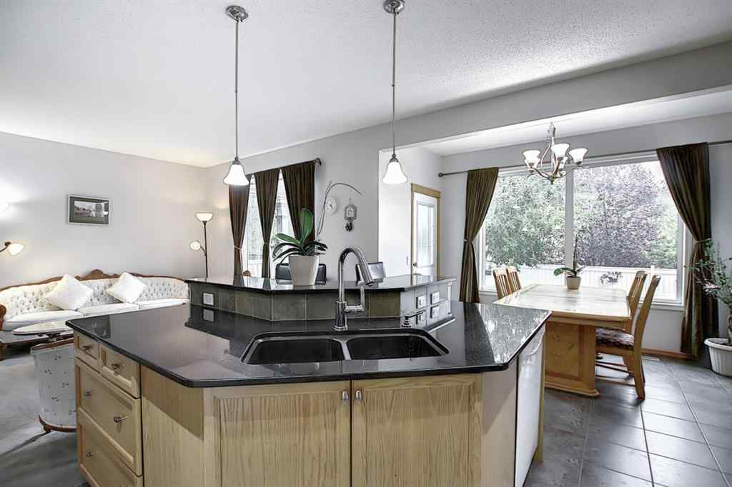 MLS® # A1036567 - 1340 KINGSLAND  Road SE in Kings Heights Airdrie, Residential Open Houses