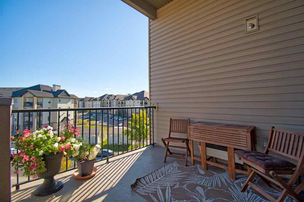 MLS® # A1037574 - Unit #9402 403 MacKenzie  Way SW in Downtown. Airdrie, Residential Open Houses