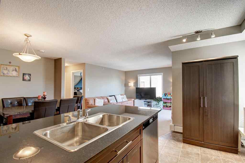 MLS® #A1037574 - Unit #9402 403 MacKenzie  Way SW in Downtown. Airdrie, Residential Open Houses
