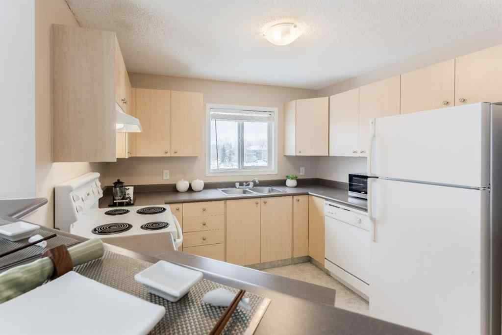 MLS® #A1039405 - Unit #6314 304 Mackenzie Way SW in Downtown Airdrie, Residential Open Houses