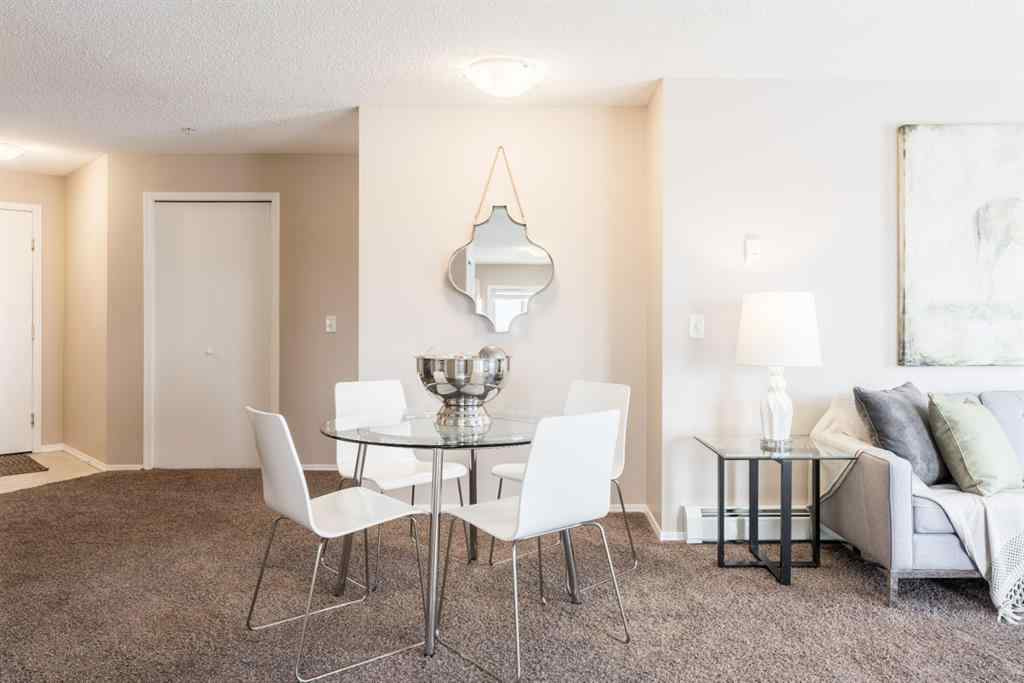 MLS® # A1039405 - Unit #6314 304 Mackenzie Way SW in Downtown Airdrie, Residential Open Houses