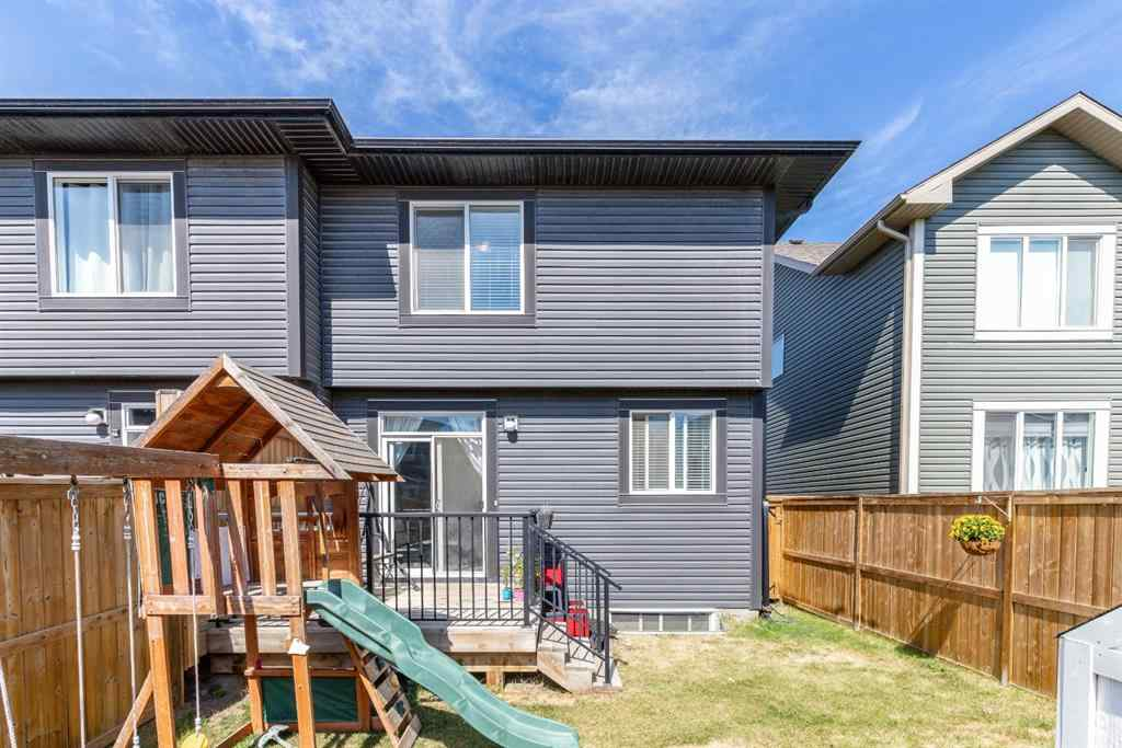 MLS® #A1040193 - 557 Midtown  Street SW in Midtown Airdrie, Residential Open Houses