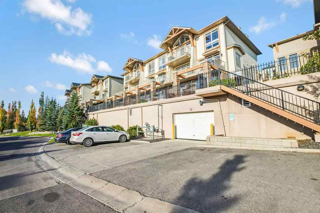MLS® #A1040787 - Unit #4 116  Rockyledge  View NW in Rocky Ridge Calgary, Residential Open Houses