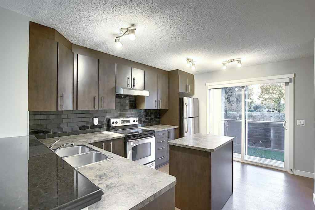 MLS® # A1041283 - Unit #906 2445 Kingsland  Road SE in Kings Heights Airdrie, Residential Open Houses