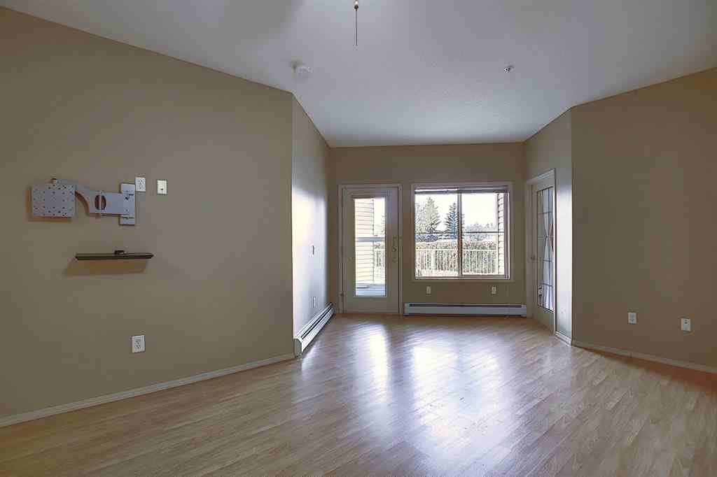 MLS® #A1041463 - Unit #102 305 1  Avenue NW in Downtown Airdrie, Residential Open Houses