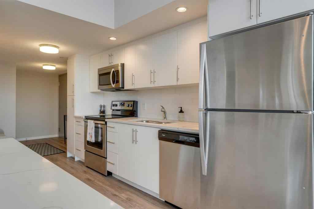 MLS® # A1041941 - Unit #405 1920 11 Avenue SW in Sunalta Calgary, Residential Open Houses