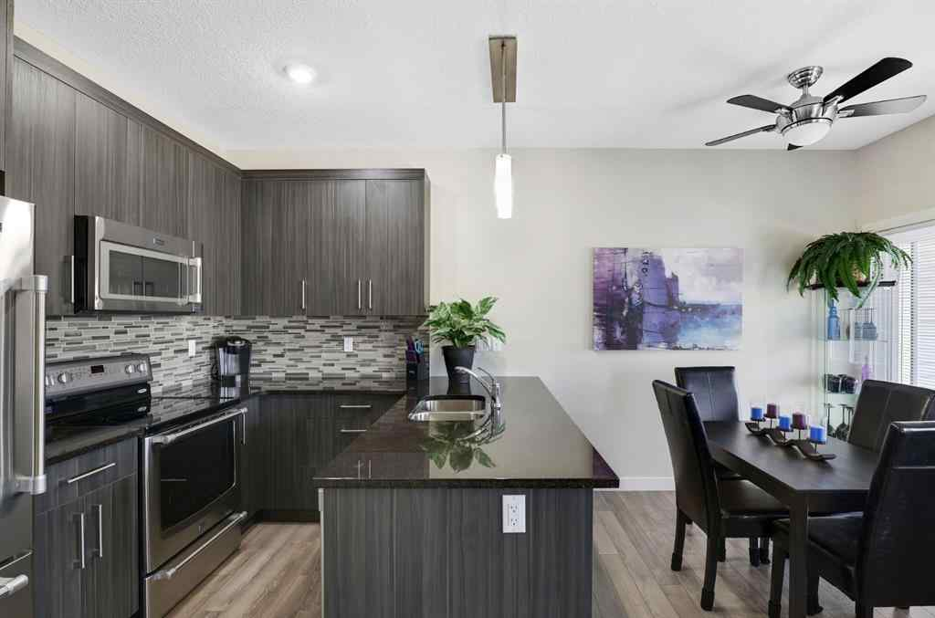 MLS® # A1043444 - Unit #155 2802 Kings Heights  Gate  in Ravenswood Airdrie, Residential Open Houses