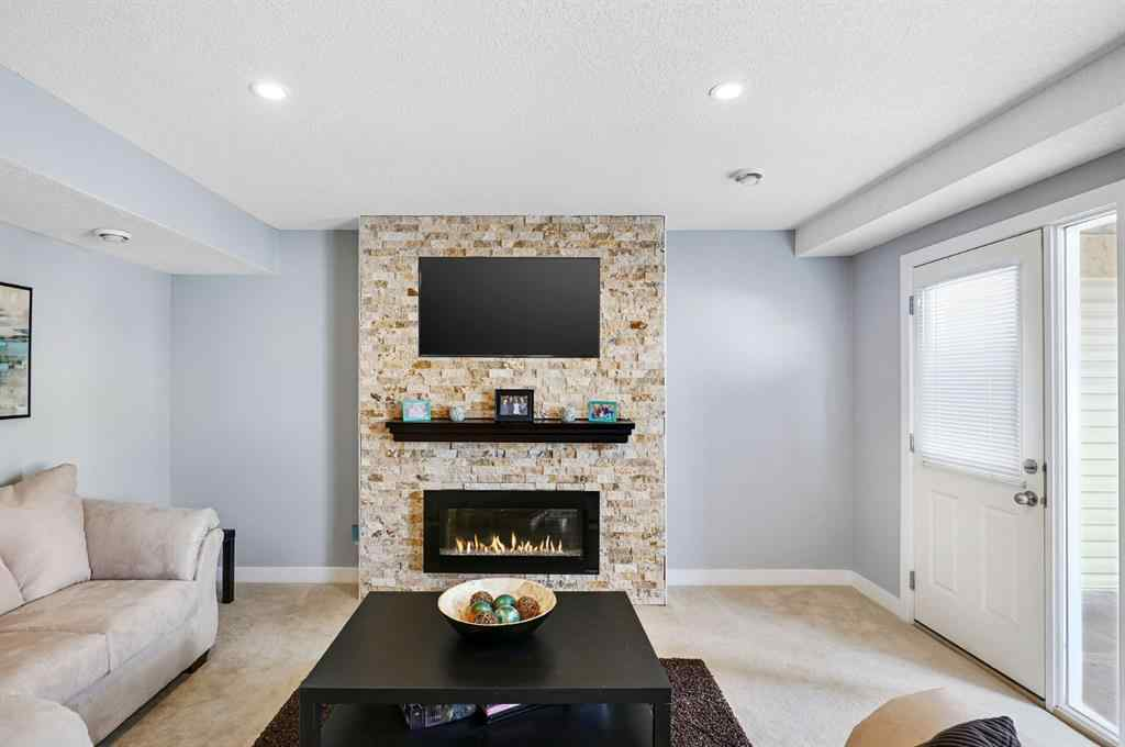 MLS® #A1043444 - Unit #155 2802 Kings Heights  Gate  in Ravenswood Airdrie, Residential Open Houses