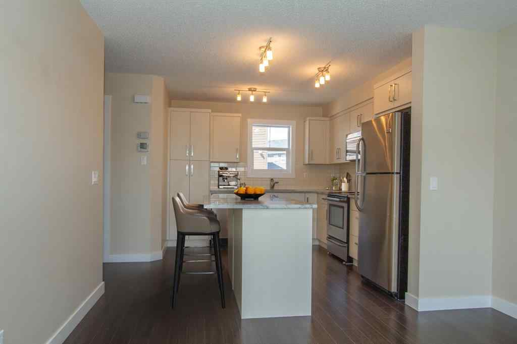 MLS® # A1045575 - Unit #1003 1225 Kings Heights Way SE in Kings Heights Airdrie, Residential Open Houses